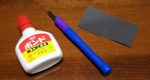 engraving knife, glue and sandpaper